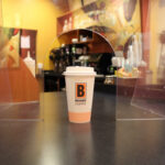 Biggby Coffee cup sitting on counter