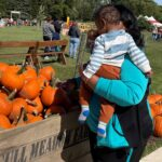 Grandmother and grandson in Gull Meadow's Pumpkin Patch