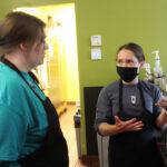 two female baristas talking